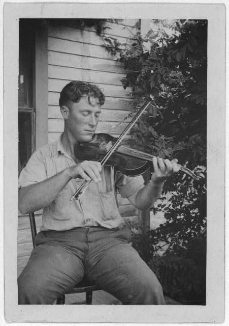 Wayne Perry playing fiddle, Crowley, Louisiana.